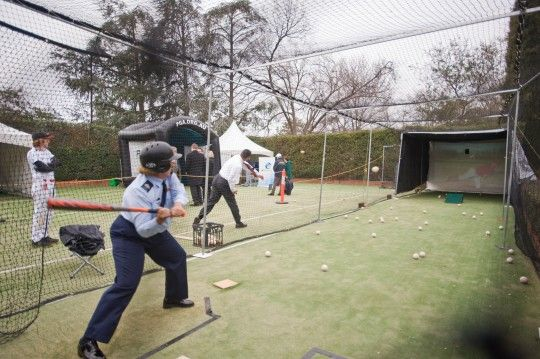 Batter Batter Swing! Guest enjoy the batting cage at the Embassy's 2014 Independence Day celebrations #July4CBR