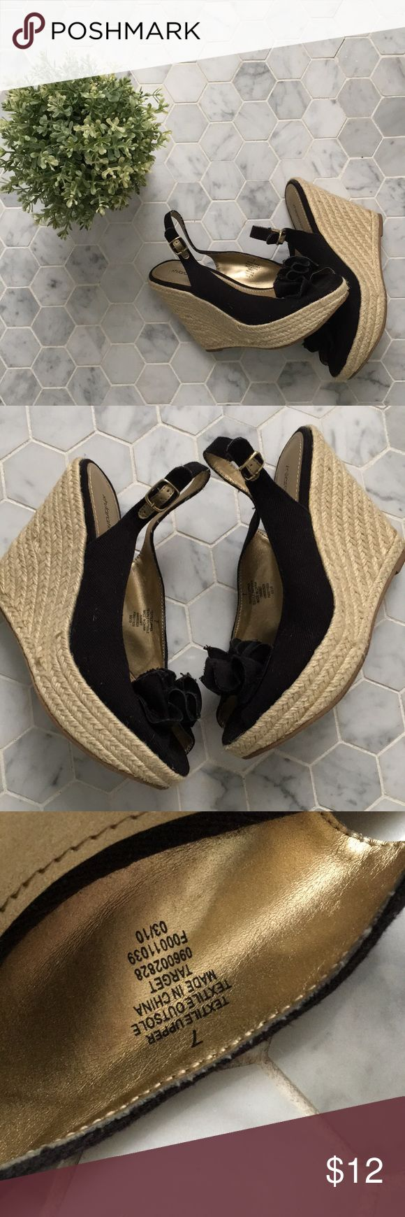 Black Espadrilles with flower detail Pre-loved black espadrilles with gold insoles, adjustable closure, flower detail. Inside of left sandal has factory defect where you can see glue. Since it's on the inside it never bothered me. Xhilaration Shoes Espadrilles