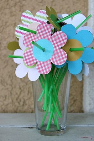 Straw flowers: cut out flower (use cutter), glue circle in middle, punch hole then push up straw from bottom until get to bendy bit, bend and flower should stay on.