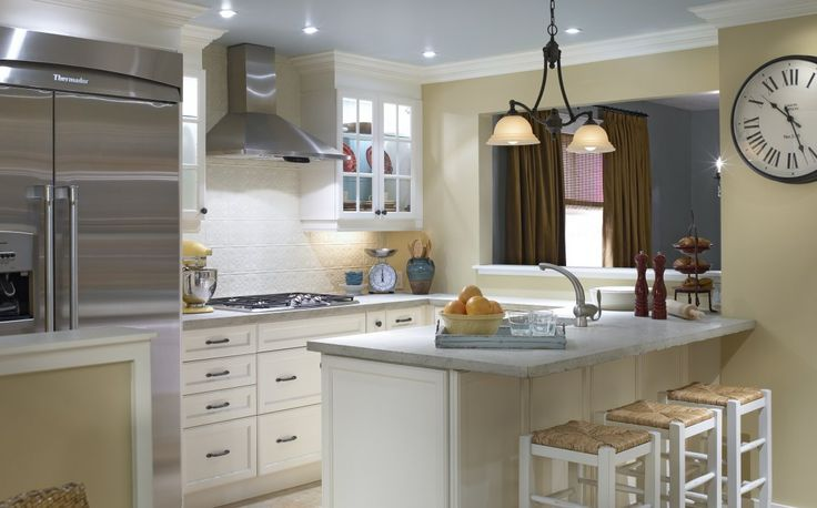 This kitchen would light up any home with its yellow walls and white cabinetry. Such smart choices!