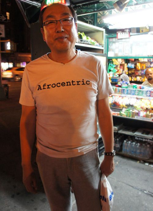 accidental Chinese hipster wearing afrocentric shirt