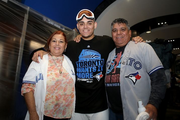 Roberto Osuna and his parents//TOR wins the ALDS v TEX, Oct 14, 2015