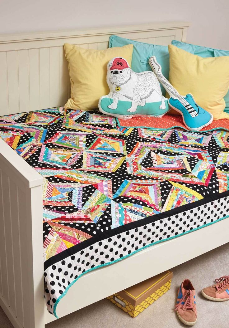String piecing is not only fun, it's a great way to use up every little scrap of fabric in this bed-size quilt pattern. String Me Along, by Dodi Lee Poulsen, is colorful and fun!