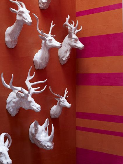 I am somewhat obsessed with faux gloss white taxidermy heads displayed in a large collection...