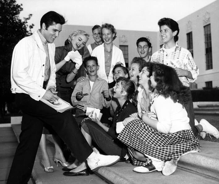 Elvis Presley meets some of his fans. Taken in 1957.