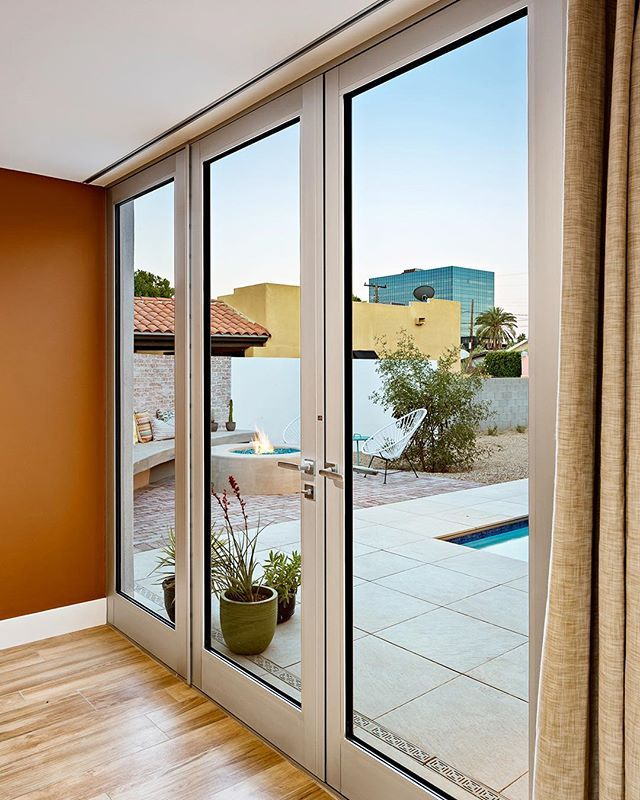 A recessed curtain track in the ceiling allows for full height glass doors out to the fire pit and pool courtyard from our 'Sol' house foyer  by @roehnerrr #design #architecture #interiordesign #interiors #home #homedecor #decor #modernhome #moderndesign #architect #archilovers #glassdoor #curtains #house #dtphx #phoenix #arizona #realestate #firepit #indooroutdoor #lifestyle #whatanarchitectdoes #willo #diy #hgtv