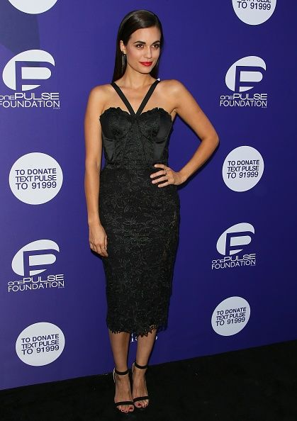 Actress Torrey DeVitto in a CRISTALLINI cocktail dress at a benefit for onePULSE Foundation in Los Angeles, California.CRISTALLINI #CocktailDress #BlackDress #MacrameLace