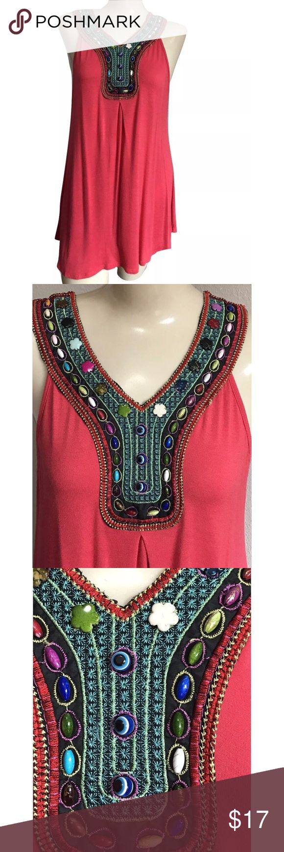 "Boho Coral Tunic Top Beaded Embroidery Size Large Tovia Sleeveless Tunic Top Size Large  Stunning Coral Jacket style Tunic Top with a beard and Embroidered V neckline. Peekaboo back with a tie that ties around the neck Skirt has. Little Flare to it for extra bounce!  90% Rayon, 10%Spandex M  Bust 17-19"" from underarm to underarm  Total Length apprx 29"" from shoulder to hem  Great pre-owned condition Tovia Tops Tunics"