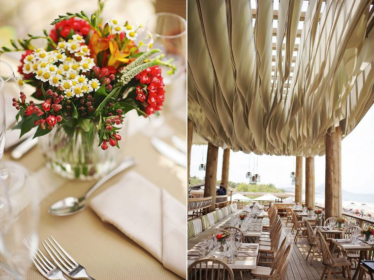 Colourful simple decoration: Chamomile, veronica flowers, red bouvardias and freesia flowers in a unique beach restaurant!