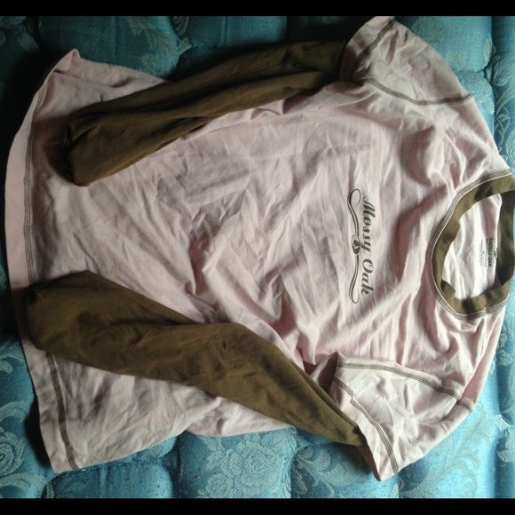 Pink and brown long sleeve top Has a hole in the left arm. Great for cold weather. I mostly used it to go skiing in on vacation. BUNDLE ONLY! IF PURCHASED ALONE IT WILL BE CANCELLED! Mossy Oak Tops