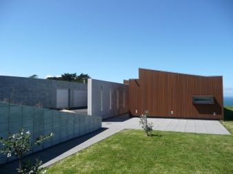 The plan consists of three cedar-clad boxes, each containing a different function