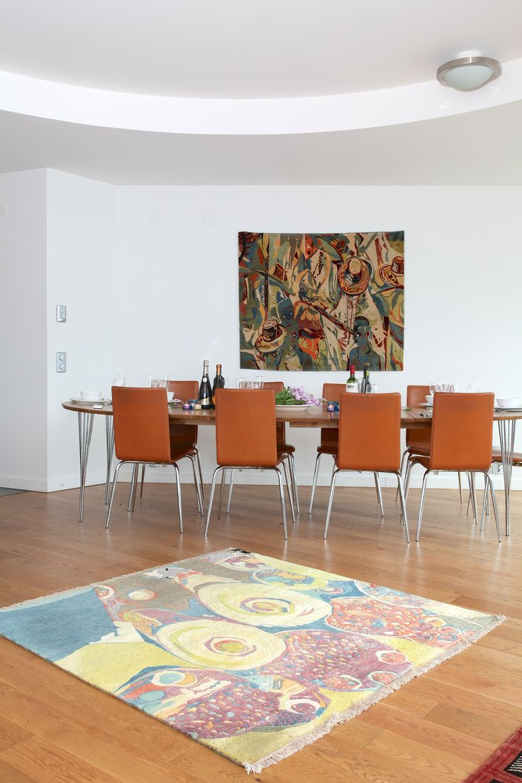 "Ehi Obinyan's rugs ""Eyo Festival"" and ""Market Scene""provide the right setting for  the dining area. #rug #homedecor #interiordesign Check out our website for more of our collection http://africaonthefloor.com/"