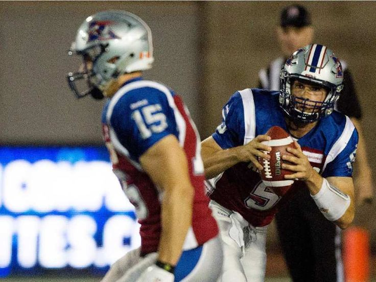 Montreal Alouettes quarterback Dan LeFevour, right, runs the ball against the Ottawa Redblacks during CFL action at the Percival Molson Stadium in Montreal on Thursday June 25, 2015. LeFevour was hurt on the play and did not return to the field. The Redblacks beat the Alouettes 20-16.
