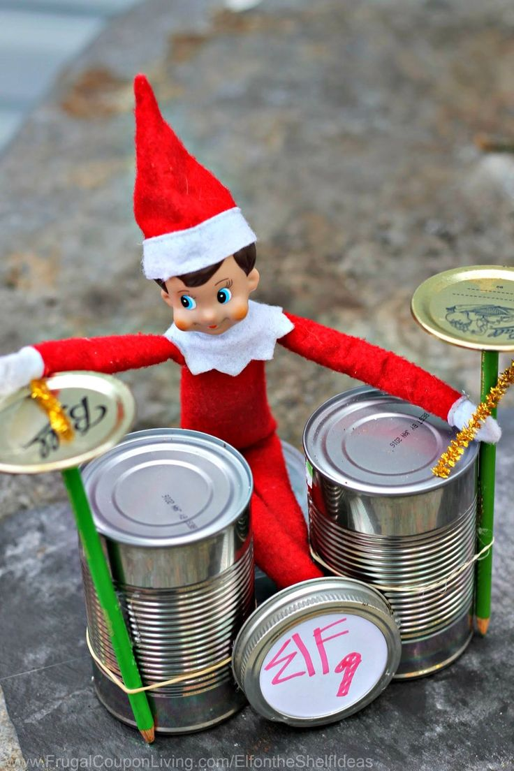 Funny Elf on the Shelf Ideas –  Elf Rock Band with Cans, Use Soup Cans for this Fun Idea. Daily Creative Elf Ideas and FREE Printables. Details on Frugal Coupon Living.