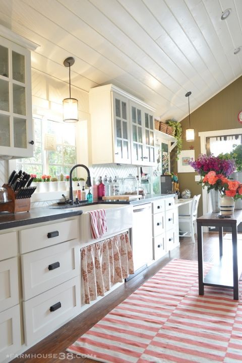 Eclectic Home Tour of Farm and Foundry - love her whimsical sense of style and this white kitchen with planked ceiling eclecticallyvintage.com