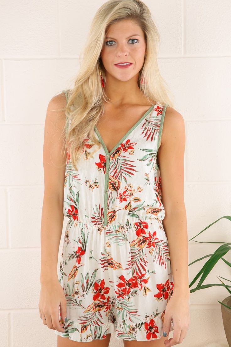 "Sometimes you ""Gotta Getaway""!! Whether flying first class or hitting America's highways and byways, bringing along this romper for your jailbreak is sure to have you feeling like a fabulous freebird, frilly and floral with no chance of turning back!! Romper features a V-neckline with button down front, elastic waist, ruffled shorts, and a deep V on the back. Model is wearing a small.  • 100% Rayon • Machine Wash Cold on Gentle Cycle • Unlined  FIT: True to size BUST: Works for most bust…"