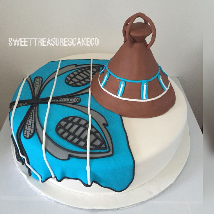 Sesotho hat and blanket African traditional wedding cake.
