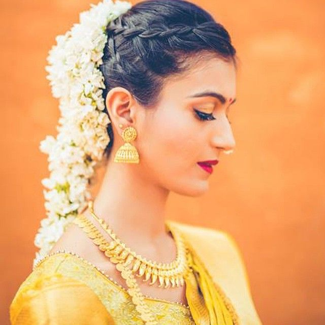 South Indian bride. Gold Indian bridal jewelry.Temple jewelry. Jhumkis. Yellow silk kanchipuram sari.Braid with fresh jasmine flowers. Tamil bride. Telugu bride. Kannada bride. Hindu bride. Malayalee bride.Kerala bride.South Indian wedding.