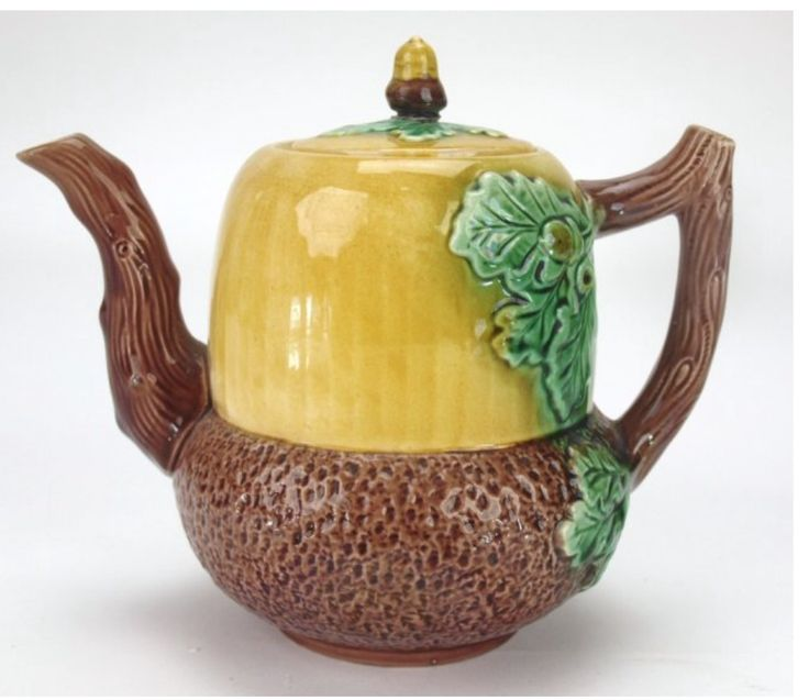 Adams and Bromley English Majolica Acorn Teapot..... applied oak leaf decoration on gold and brown acorn shape, wood stem handle and spout, ceramic, UK