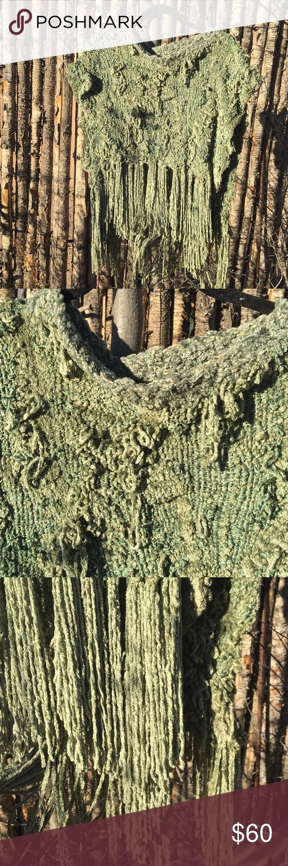 Beautiful Hand Woven Designer Sweater/poncho Hand woven designer open sided sweater/poncho. Lovely shades of aquamarine chenille. Soft and cozy. Open sides. 10 inch varied fringe. 14 Inches from Front Neck to beginning of fringe. 22 inches across open at sides Sweaters Shrugs & Ponchos