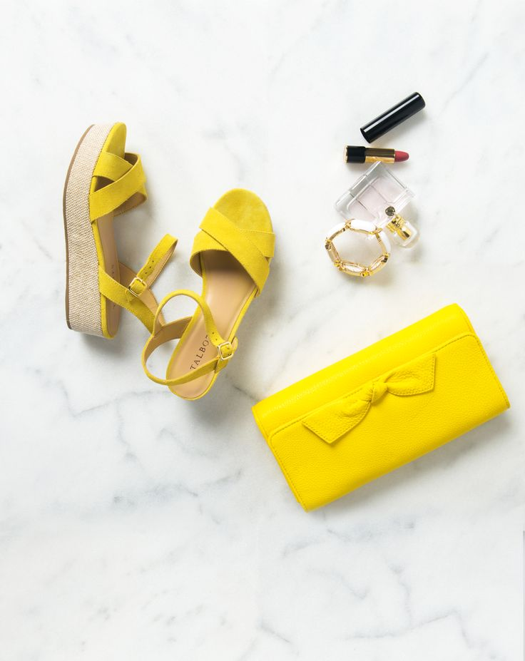 The perfect statement makers: pair your yellow espadrilles with a matching bow clutch.