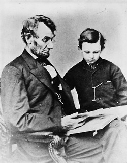 President Abraham Lincoln with his son Tad, 1864.