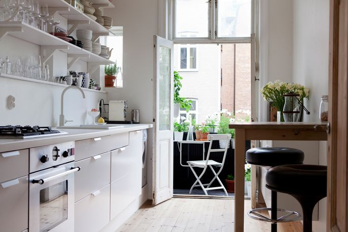 Sweet little kitchen...especially love the outdoor dining space!