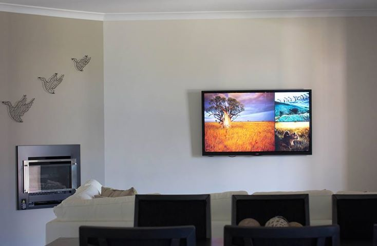 A TV Mounted by Macktronix inside an award winning display home constructed by local builders Afonso Homes.