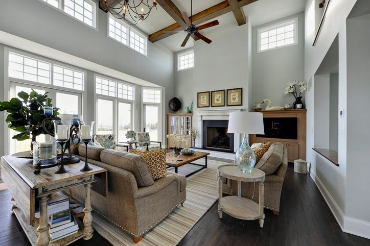 Stunning two story family room painted a crisp white with