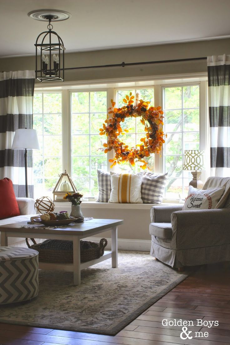 Fall decor in living room with Ikea hack plank coffee table and striped drapes