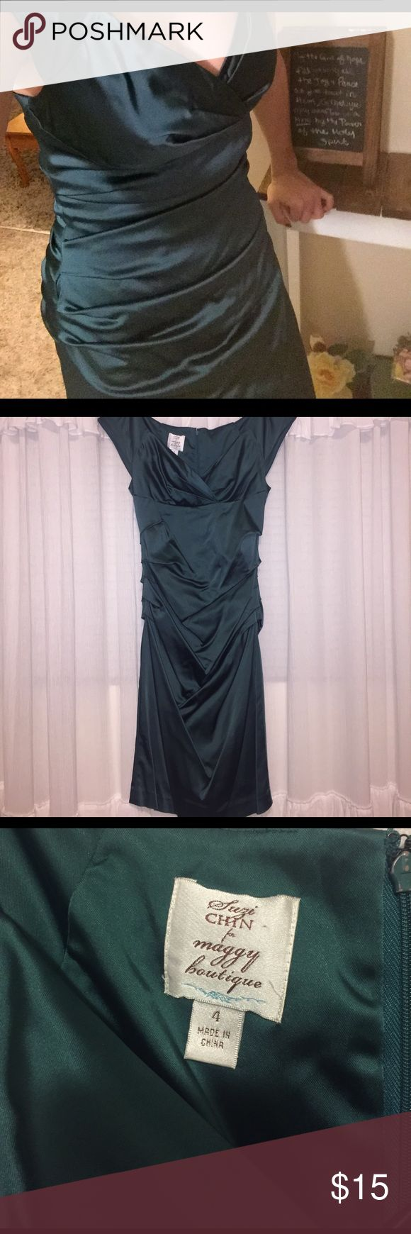 Suzi Chin for Maggy Boutique Cocktail Dress Beautiful green vintage style cocktail dress. I wore it to a Christmas party once and it's been hanging in my closet since. No flaws to note, but needs a good steaming or dry clean. Size 4, but can fit a larger bust. I'm a 32D and there was still room in the chest area. 💕Bundle and save 25%! Free shipping on orders over $30 (after discount). Just use the offer button to subtract $7 from your total! 💕 Suzi Chin for Maggy Boutique Dresses
