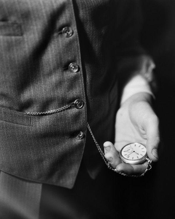 Man Looking at Pocket Watch