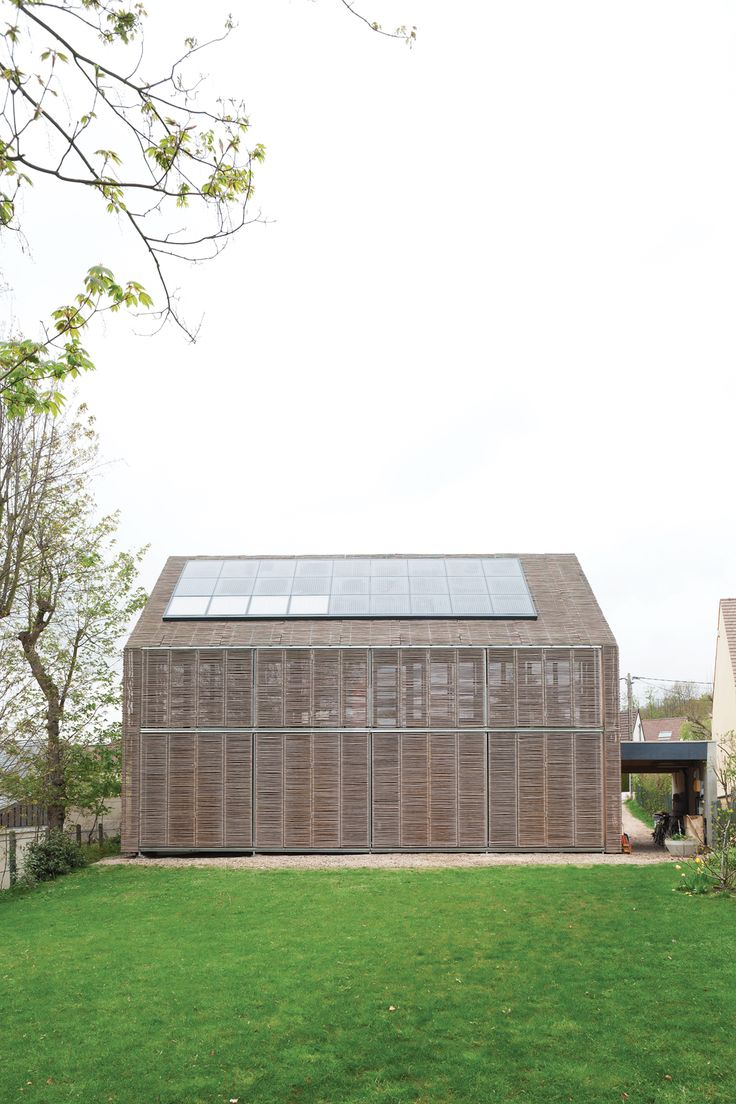 Among the first Passive Houses in France, this bamboo-clad farmhouse by the Parisian firm Karawitz Architecture brings a bit of green to tiny Bessancourt