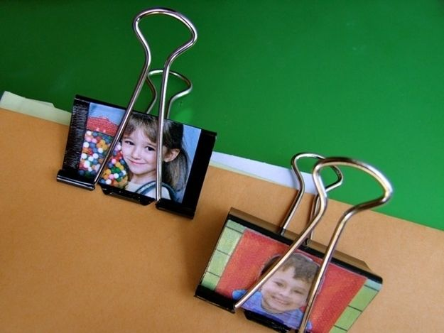 Similarly, you can print out photos and glue them onto binder clips and use them for hanging artwork.