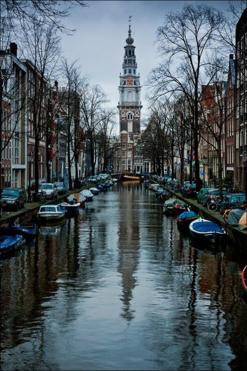 Pretty photo of the canal, boats and homes in Amsterdam, Netherlands.  Go to www.YourTravelVideos.com or just click on photo for home videos and much more on sites like this.