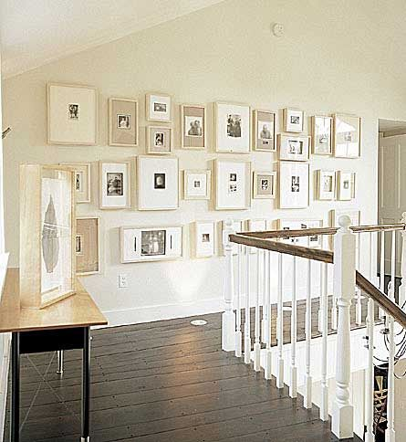 Beautiful wall of framed photos in a neutral pallete