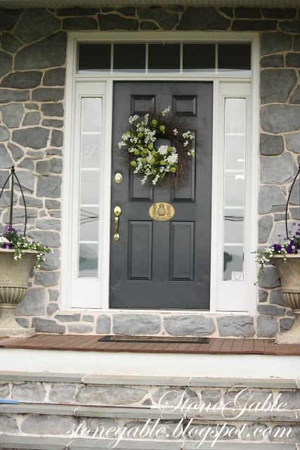 STONE FRONT with DOOR in GRAY PAINT and WHITE SURROUND.