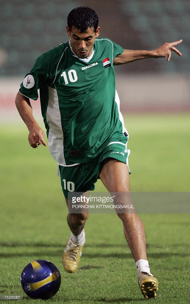 bangkok-thailand-iraqi-football-player-younes-khalef-controls-the-a-picture-id75303307 (640×1024)