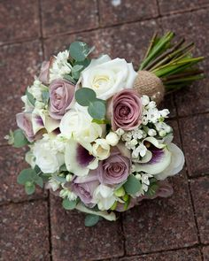 Vintage lilac Amnesia roses with puple and white calla lilies , silver eucalyptus , white bouvardia and tied with hessian ribbon