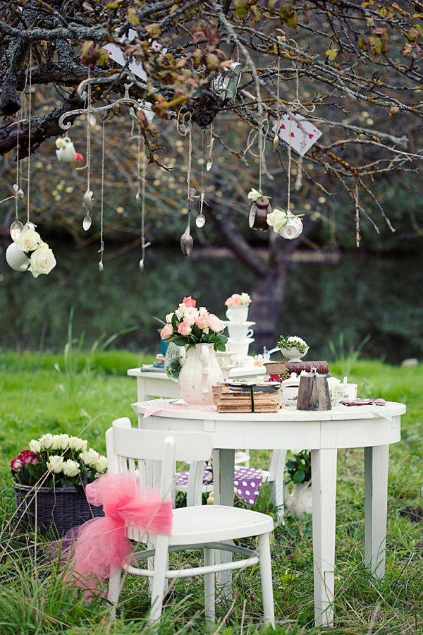 It would be so cute to hang cards off trees in their backyard! and teacups and whatnot.
