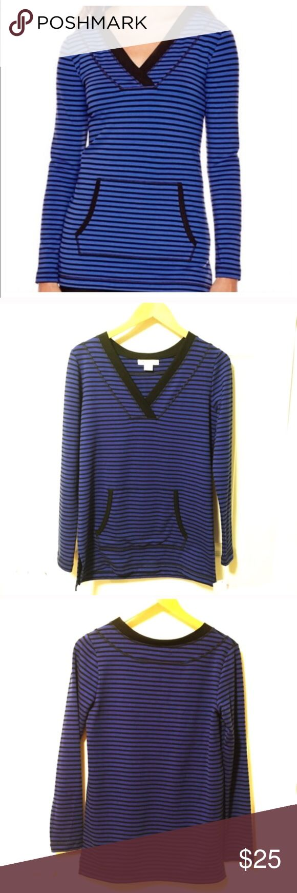 """Blue & Black Striped Tunic with Kangaroo Pocket An overlapping v-neckline and kangaroo pocket mean this striped tunic will give you equal parts function and style. approx. 27"""" - 30"""" length polyester/rayon/spandex. Color is most like first picture. 🙂  🔺Like the item but not the price? Submit an offer using the offer button. Every offer is considered. 🔺Bundle 2 or more items to receive a 20% discount & pay 1 shipping fee. 🔺Questions? Please ask. I want your Poshmark experience to be…"""