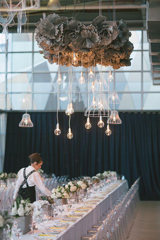 Phenomenal lighting display with grey ruffles and clear bulbs.     via http://www.polkadotbride.com/2012/08/em-and-maxs-modern-city-wedding/