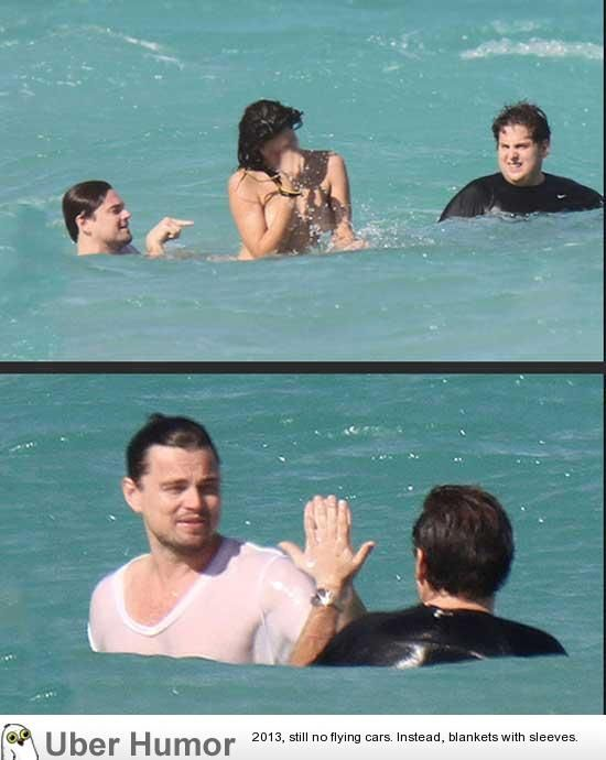 Leo Dicaprio and Jonah Hill share a high-five after swimming with a topless woman in Miami