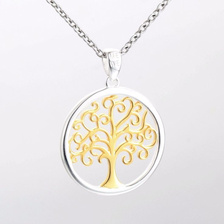 Silver and Gold Intertwined Tree of life this expertly crafted drop pendant. 14K yellow gold tree of life centres and sterling silver surround .#treeoflife