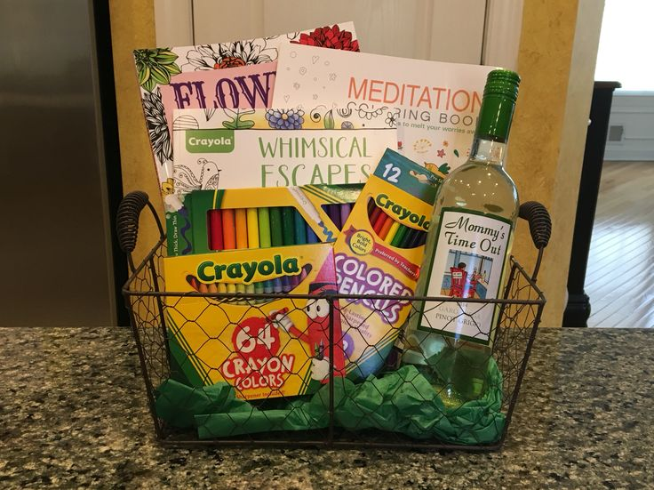 """Mommy's Time Out basket I made for our tricky tray. It contains adult coloring books, colored pencils, markers, crayons and a bottle of """"Mommy's Time Out"""" Pinot Grigio."""