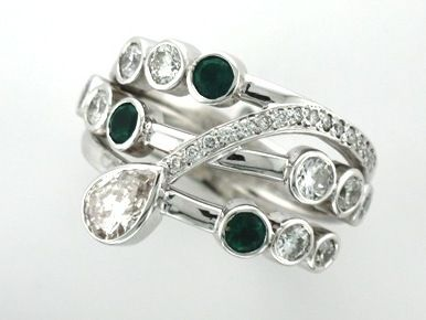 'NATALIE'  Signature Emerald & Diamond Wave Ring Designed from Client's Existing  Diamonds & Emeralds with Accent Diamonds for Extra Luxury.      Custom made in 18ct White Gold as a Right Hand Ring.