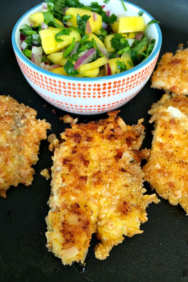 This Coconut Crusted Tilapia with Mango Salsa is delicious served for lunch or dinner, and makes great fish tacos, too!