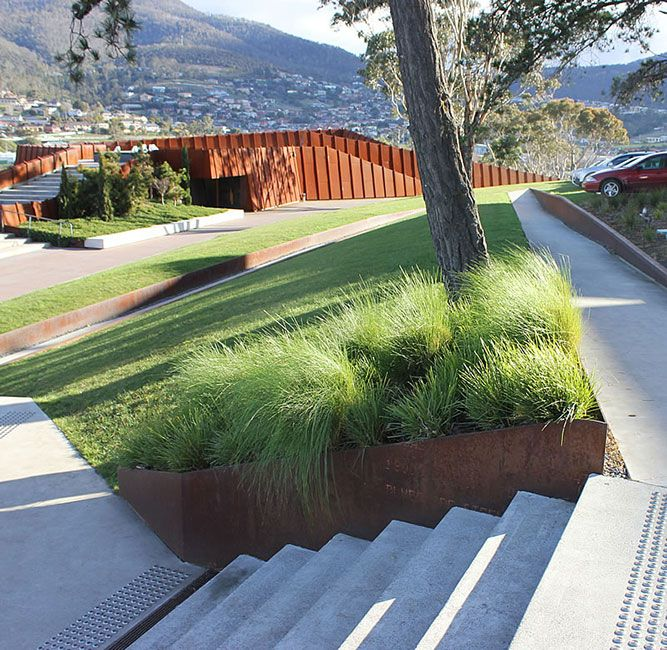 Corten with terraced lawn oculus / mona museum grounds, hobart