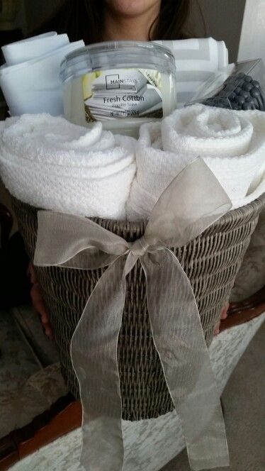 House warming gift basket. (For the bathroom- in a trash can include towels, shower curtain, candle, or any bathroom item)