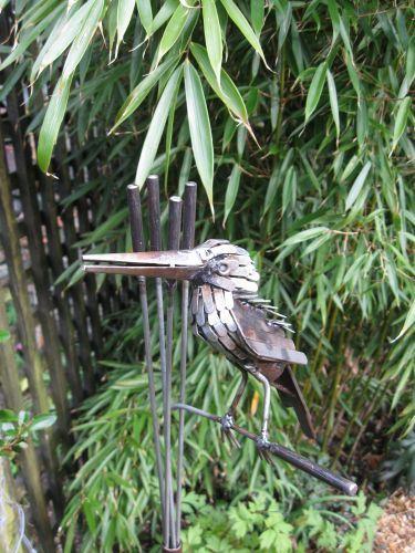 Kingfisher metal bird sculpture on a stake
